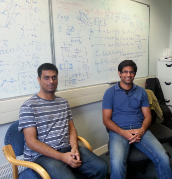 With Vijay at the computer vision lab, Cambridge, 2015. The whiteboard behind shows a recent work on understanding symmetries in deep learning.